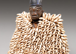 "Yoruba Figure, female ""Ereibeji"" with cowrie shell tunic, n.d. Wood, pigment, beads, shells 10 ½ x 9 in NSU Art Museum Fort Lauderdale, gift of Mr. and Mrs. Edward Durell Stone, Jr.; A72.44"