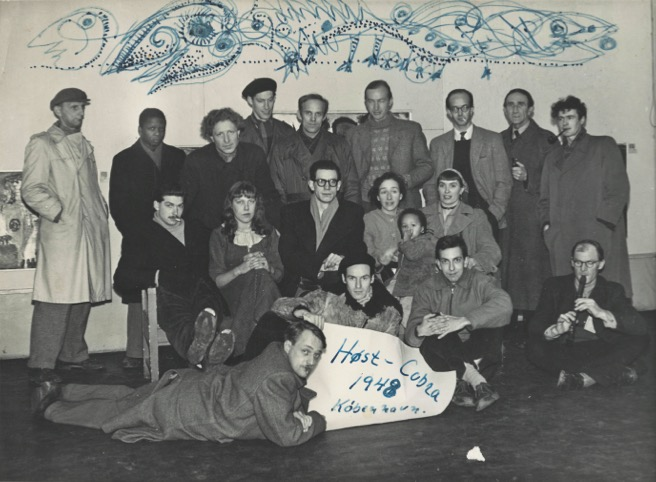 Cobra Collection, Group photograph of Future artists for the Høst exhibition in Copenhagen, 1948. Background drawing by Carl-Henning Pedersen. Courtesy of the Cobra Museum.