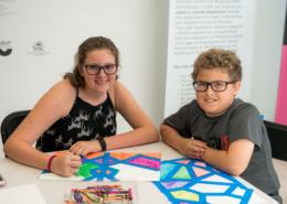 a boy and a girl doing art work