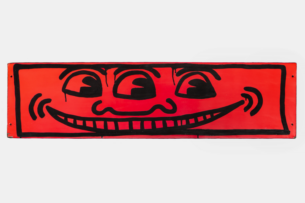Keith Haring (b. 1958, Reading, PA; d. 1990, New York, NY) Untitled (3 Eye Smiley Face), 1982 Enamel on sheet metal 9 ¼ x 35 7/8 inches Private Collection, Florida © Keith Haring Foundation